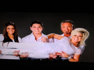 Theresa Caputo, Larry Caputo, Victoria Caputo and Larry Jr. Caputo's new family photograph.