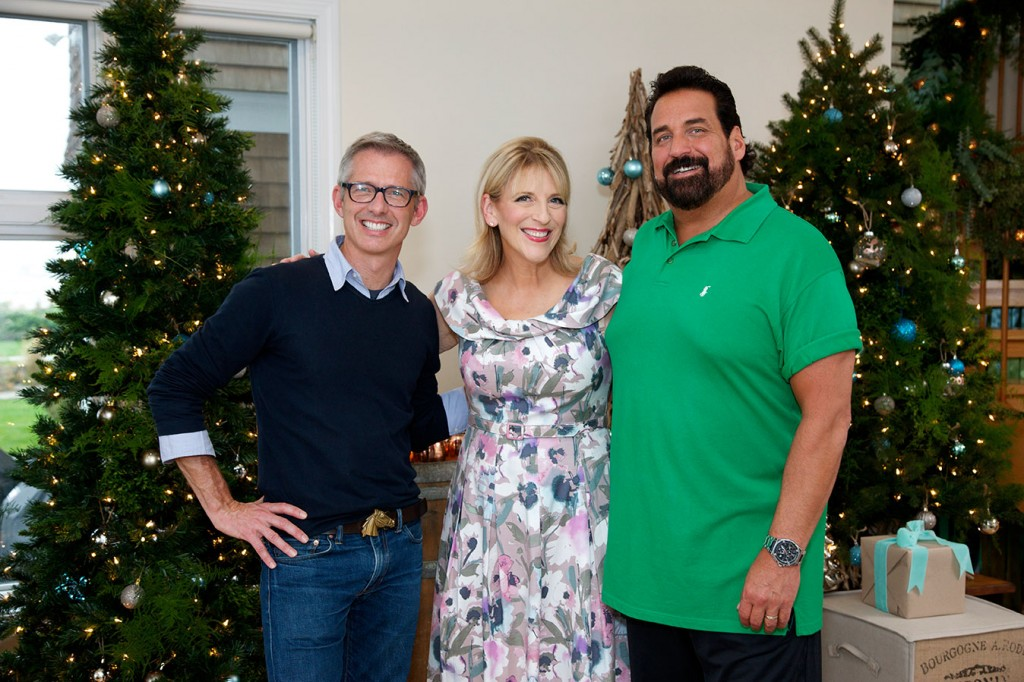 "Lisa Lampanelli (center) stands alongside designer Bryan Rafanelli (left) and her husband Jimmy Cannizzaro for HGTV's ""Celebrity Holiday Homes"""