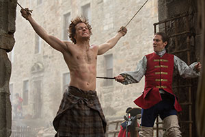 Sam Heughan as Jamie Fraser and Tobias Menzies as Black Jack Randall in Starz' new series Outlander
